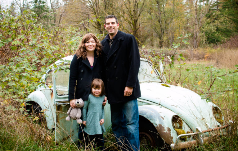 family standing in front of old vw bug