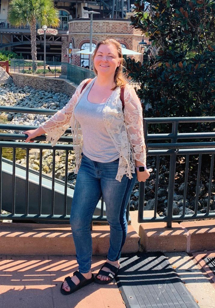 Woman posing on bridge at Disney Springs.