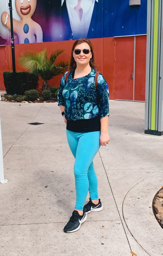 Woman posing in front of Madam Tussauds in Orlando.