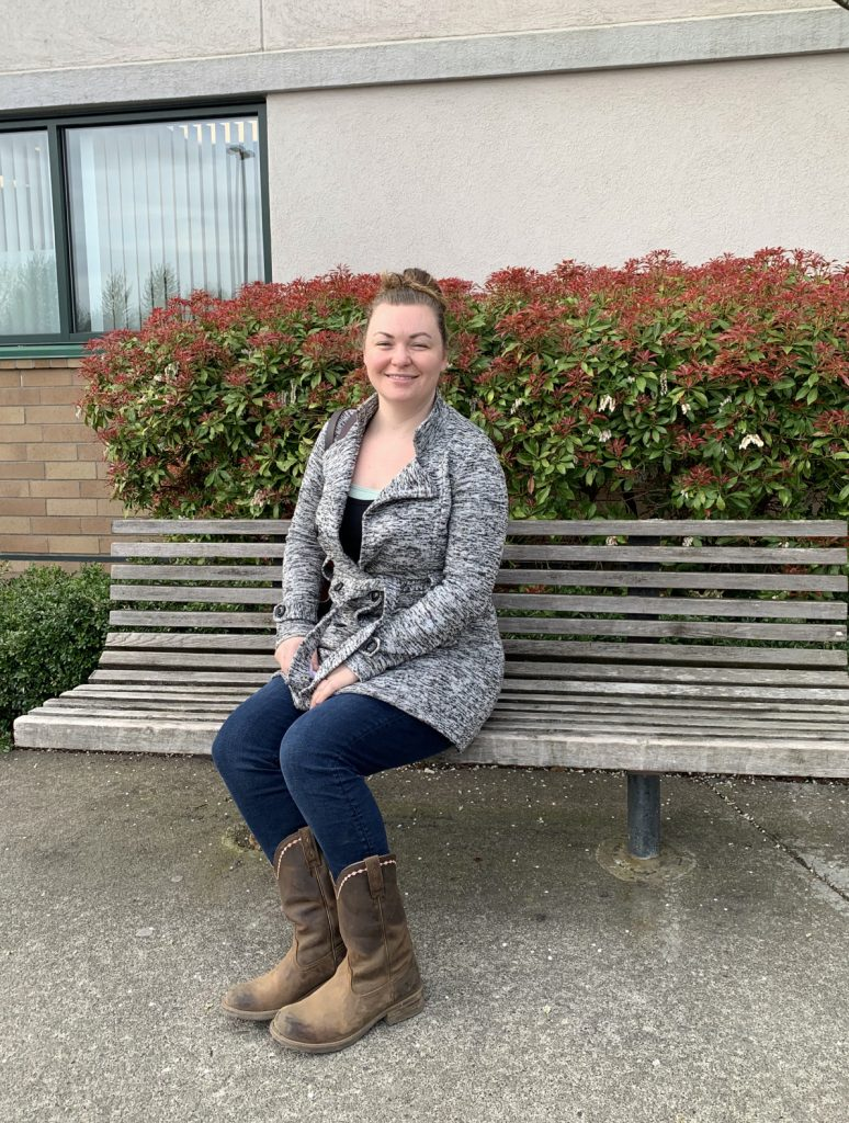 Woman sitting on a bench.