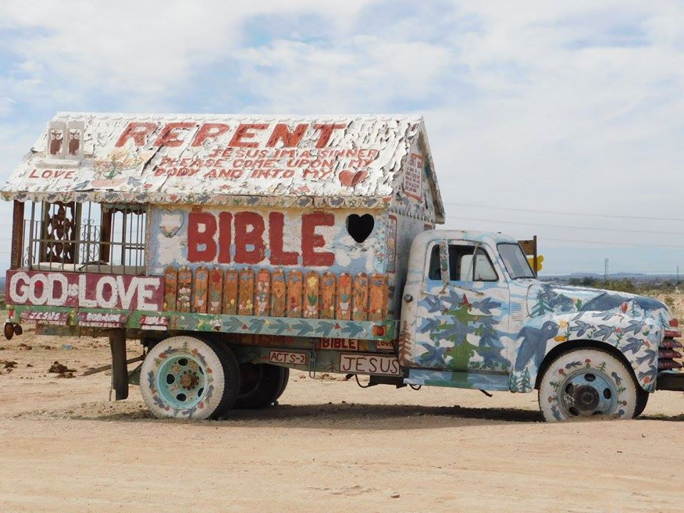 Truck painted with folk art.