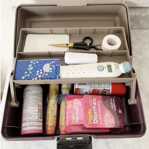 First aid supplies in a tackle box.